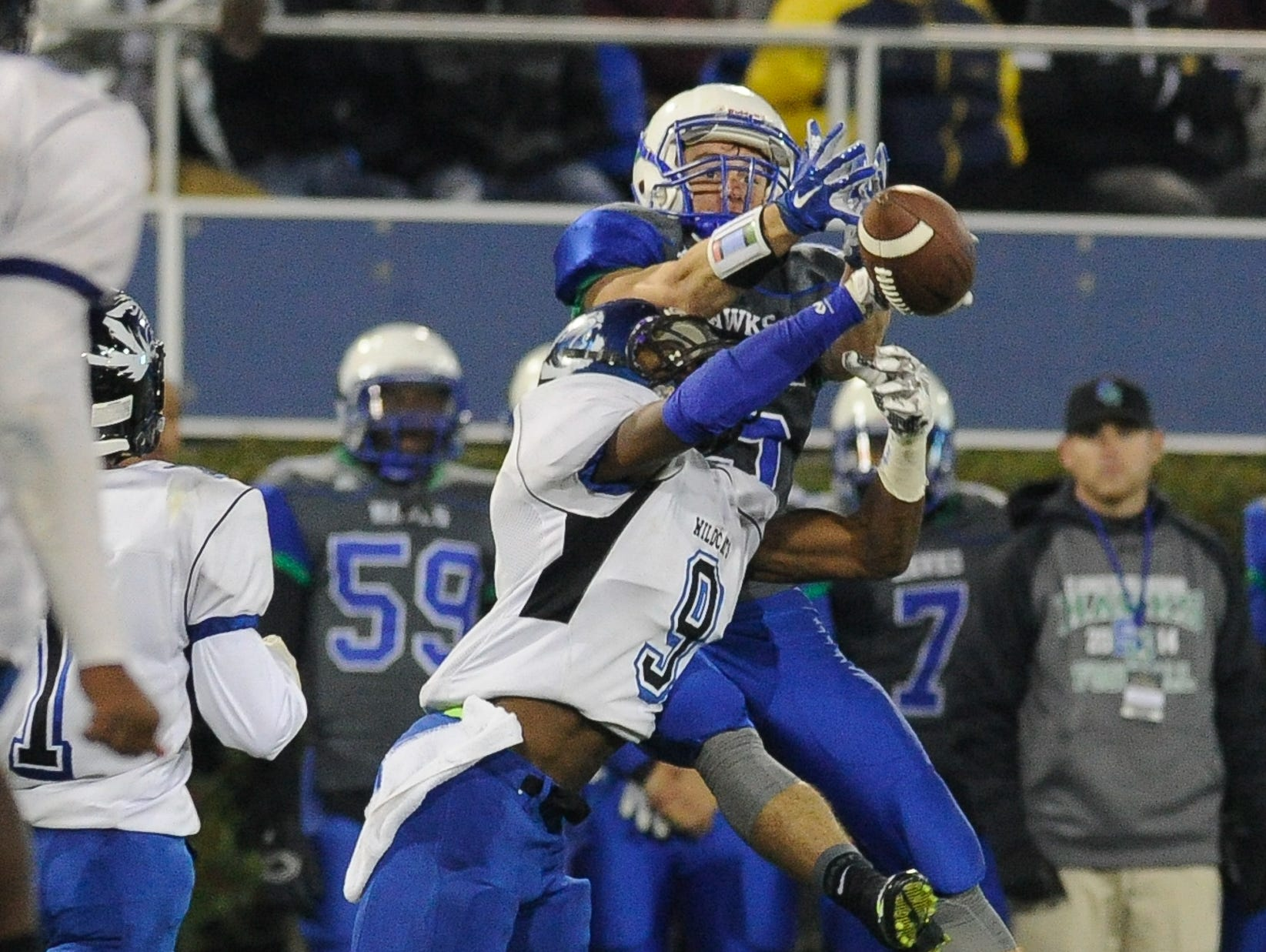 Howard's #9 Malik Banks stops a pass attempt during the Division II championship against St. Georges.