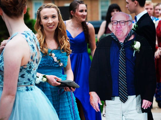 Allison Closs arrives for the Carlisle High School senior prom at Letort View Community Center at Carlisle Barracks in Carlise, Pa., on Friday, May 11, 2018, with a cutout of actor Danny DeVito. Closs and her famous two-dimensional date joined other Carlisle High School seniors Friday for prom. Closs purchased the cutout of DeVito online along with a scooter she used to move the figure with.