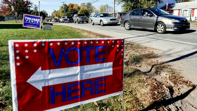 Cars sit along Davidsburg Road as drivers wait to turn into the Dover Township Community Center polling place Tuesday, Nov. 8, 2016. Amanda J. Cain photo