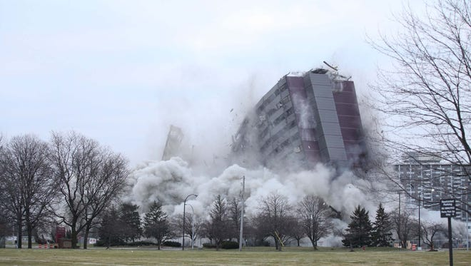 The North Park Plaza Building implodes on Sunday, Dec. 14, 2014 in Southfield.