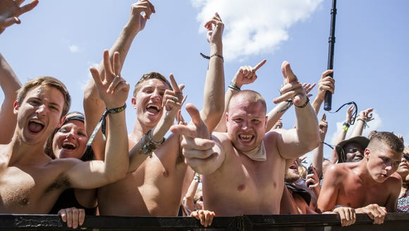Fans cheer as Steve Aoki performs on The Backyard stage