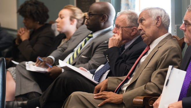 New Castle County Councilman Jay Street listens as the House of Representatives addresses the Wilmington redistricting bill during a session at Legislative Hall on Wednesday. The plan received approval.