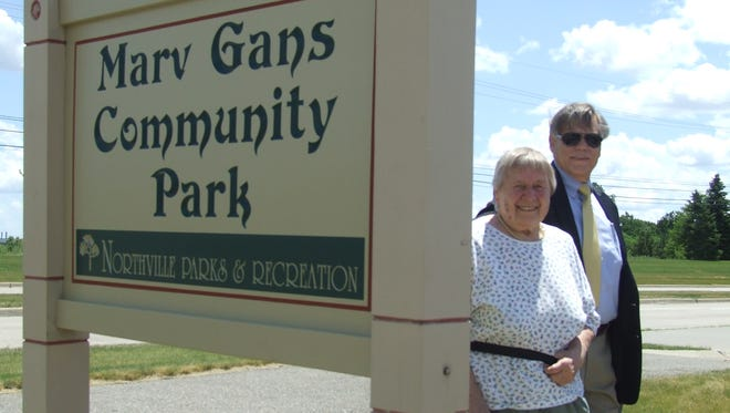 Rikki Gans, who was married to Marvin Gans for 60 years, with Northville Township Supervisor Bob Nix after the unveiling of a new sign at the renamed Marv Gans Community Park on Saturday.