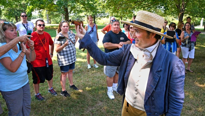 "Brian Allison shows a dueling pistol to the crowd during the new visitor experience at the Hermitage, ""The Duel — Art of the Southern Gentleman,"" on Saturday, July 22, 2017, in Hermitage, TN."