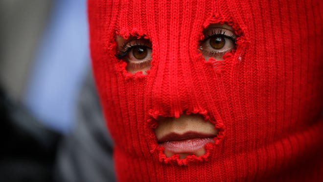 A member of Pussy Riot, photographed during a press conference Feb. 20 in Sochi, Russia. The band will perform at Chicago's Riot Fest and participated in a panel discussion.