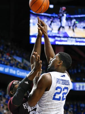 Kentucky's Alex Poythrees gets his shot tipped by Mississippi State's Gavin Ware.   Jan. 12, 2016