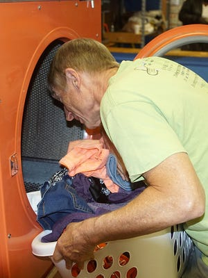 Lee Richardson leads the laundry crew each Friday