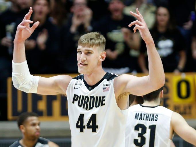 Isaac Haas of Purdue encourages the Boilermakers faithful