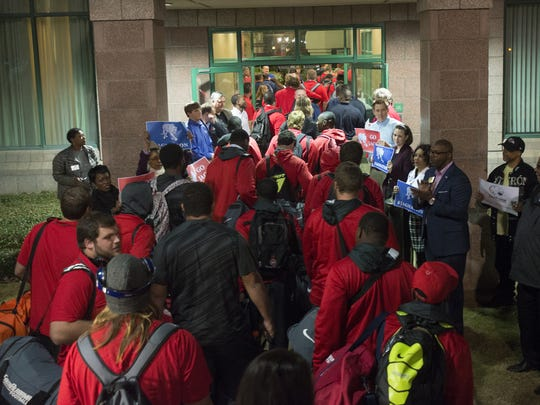 University of South Alabama football team arrives at the Embassy Suites in downtown Montgomery, Ala., on Tuesday, Dec. 16, 2014 for the Raycom Media Camellia Bowl.