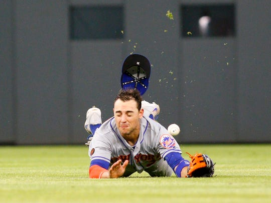 May 29, 2018; Atlanta, GA, USA; New York Mets center fielder Michael Conforto (30) dives for a ball against the Atlanta Braves in the eighth inning at SunTrust Park.