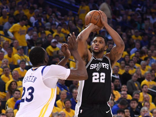 April 24, 2018; Oakland, CA, USA; San Antonio Spurs forward Rudy Gay (22) shoots the basketball against Golden State Warriors forward Draymond Green (23) during the second quarter in game five of the second round of the 2018 NBA Playoffs at Oracle Arena. Mandatory Credit: Kyle Terada-USA TODAY Sports
