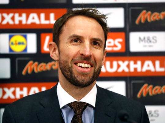 Gareth Southgate the newly confirmed England soccer team manager smiles as he listens to a question during a press conference in the headquarters of the English Football Association at Wembley stadium London, Thursday, Dec. 1, 2016. (AP Photo/Frank Augstein)