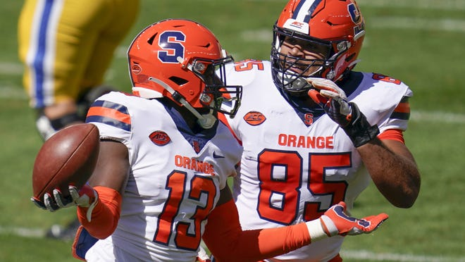 Syracuse linebacker Mikel Jones (13) and Josh Black (85) celebrate a fumble recovery last Saturday against Pitt. The Orange are hoping for their first win of the season on Saturday with Georgia Tech visiting the Carrier Dome.