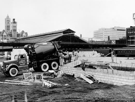 Work is well underway on the first building to be erected in the industrial development of the Gulch, formerly occupied by switching yards of the NC & St.L-L&N railroads. It will be a 13,000-square-foot office-warehouse of Wayne Distributing Co., which sold livestock and poultry feed. (February 1956)