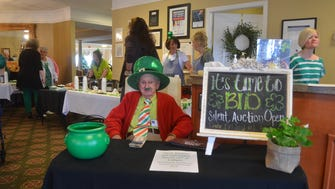 Homer Bradley takes money for Morningside of Gallatin's 2018 St. Patrick's Day Chili Cookoff and silent auction fundraiser for Sumner County Food Bank.