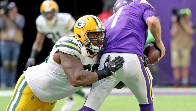 Green Bay Packers defensive end Mike Daniels (76) hits quarterback Case Keenum (7) against the Minnesota Vikings Sunday, October 15, 2017 in Minneapolis, Minn.