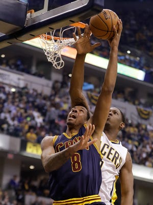 Cleveland Cavaliers' Channing Frye (8) shoots against Indiana Pacers' Kevin Seraphin during the first half in Game 4 of a first-round NBA basketball playoff series, Sunday, April 23, 2017, in Indianapolis.
