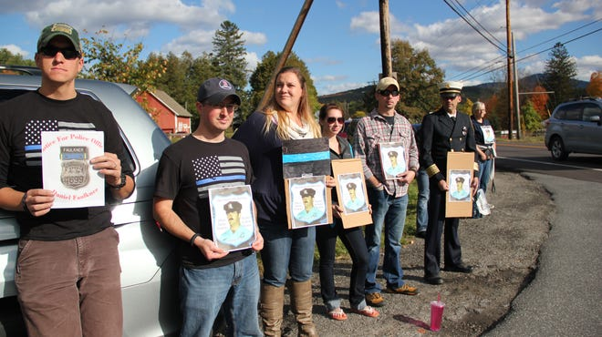 Protesters stand on the side of the road outside of Goddard College in support of slain Philadelphia police officer Daniel Faulkner on Sunday.