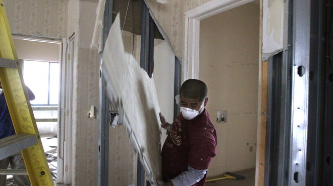 Many property owners had to pay companies to rip out drywall, creating scenes like this one from 2011.