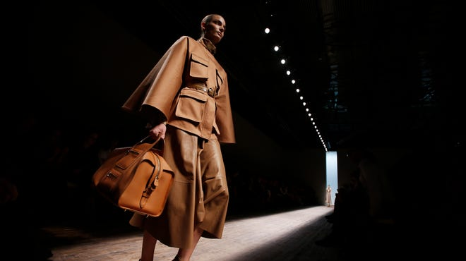 A model wears a creation for Ferragamo women's spring-summer 2015 collection, part of the Milan Fashion Week, unveiled in Milan, Italy, Sunday.