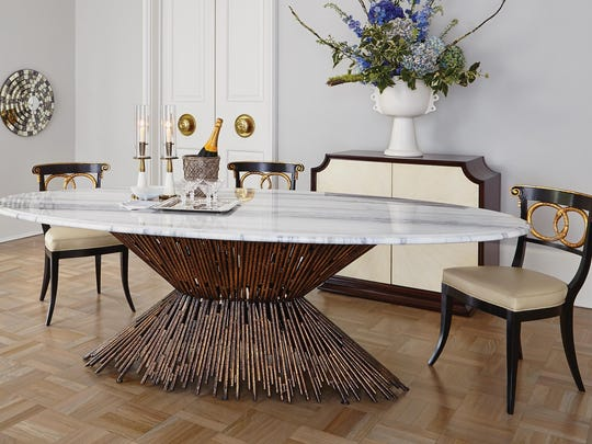 This intriguing dining room table can accommodate a glass or stone top.