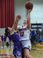 Reno's Dominigue Harding shoots with with Spanish Springs' Naelia Pinedo covering her in Tuesday's game at Reno High.