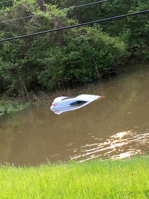 A vehicle is submerged in a Rankin County creek.