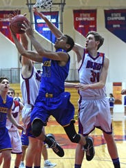 Reed's Tyler Wilson goes up to shoot with Luke Stovak,