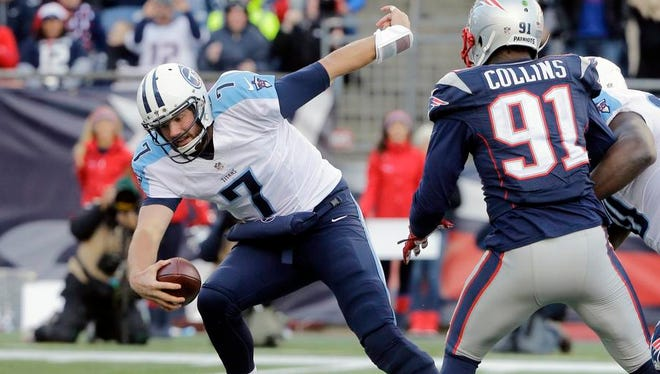 Tennessee Titans quarterback Zach Mettenberger (7) eludes New England Patriots linebacker Jamie Collins (91) in the second half of an NFL football game, Sunday, Dec. 20, 2015, in Foxborough, Mass. (AP Photo/Steven Senne)