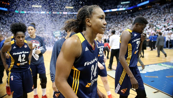 Indiana Fever forward Tamika Catchings (24),middle, and her teammates walk off the floor after falling to the Minnesota Lynx. The Indiana Fever lost to the Minnesota Lynx 52-69 in Game #5 of the WNBA Finals Wednesday, October 14, 2015, evening at Target Center in Minneapolis MN.