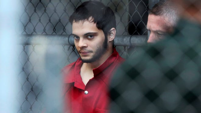 Esteban Santiago is taken from the Broward County main jail as he is transported to the federal courthouse in Fort Lauderdale, Fla., on Monday, Jan. 9, 2017.