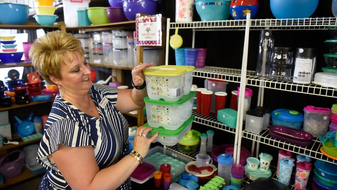 Pam Meyer talks about the features of Tupperware products on display in her booth during the first day of the Stearns County Fair Wednesday, July 26, in Sauk Centre.