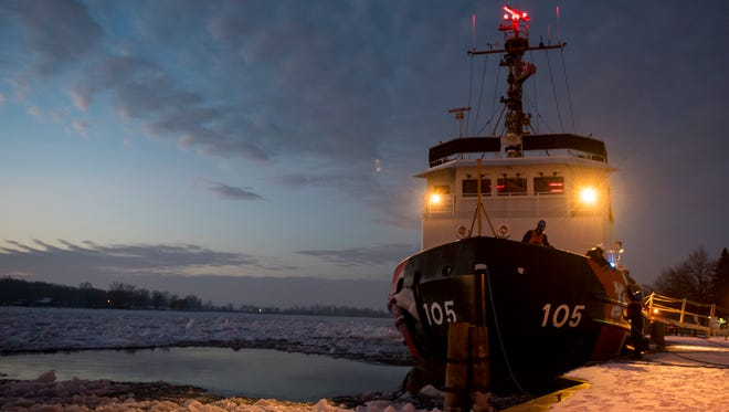 The sun rises behind the USCGC Neah Bay before launching from Algonac Jan. 10.