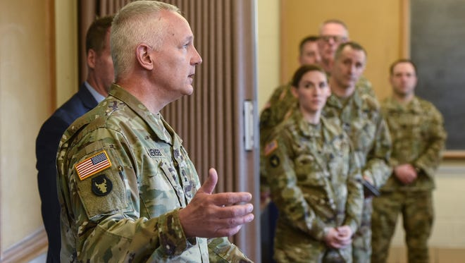 Maj. Gen. John Jensen answers questions about a proposed $8.9 million renovation project following a tour at the armory building Wednesday, April 11, in St. Cloud.