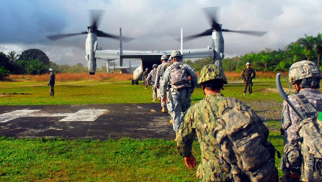 Military personnel supporting Operation United Assistance board a Marine Corps aircraft heading to Liberia on Oct. 17.