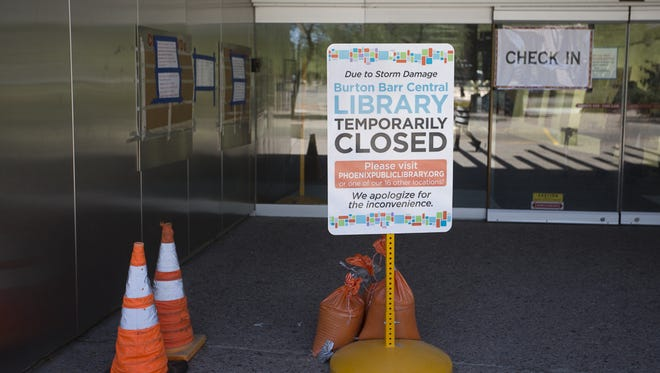 A sign outside of the Burton Barr Central Library tells visitors the library is closed in Phoenix on Aug. 18, 2017.