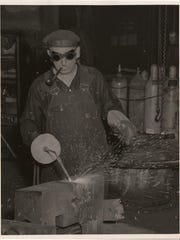 "An employee works in the now-defunct Bethlehem Steel Factory's ""Boiler Shop 3"" in an undated photograph."