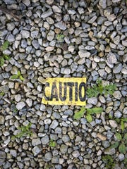 Mon., May 15, 2017:  Remnants of caution tape are visible
