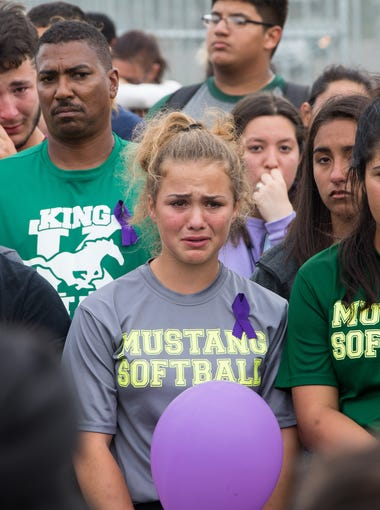 King High School students gather Wednesday, March 28, 2018, during a vigil for Rai-ane Garza, 16, who was killed by a hit-and-run driver Tuesday, March 27, 2018, just off campus.