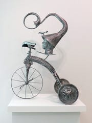 """""""Time Traveler,"""" using castoff items, by John Carroll Long, part of the """"Passionately Repurposed"""" show in the Naples Art Association at the von Liebig Art Center."""
