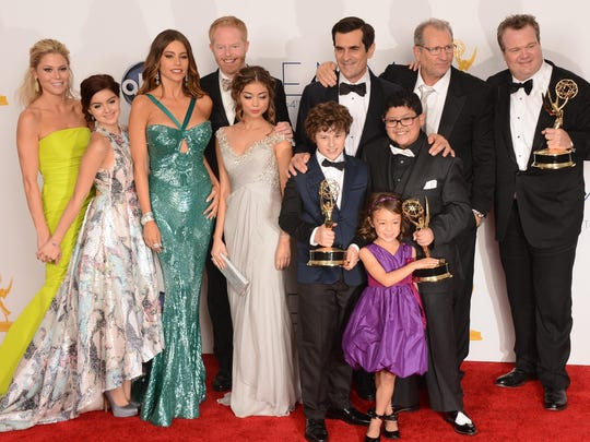 The cast of Modern Family poses at the 64th annual