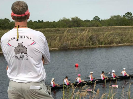 Intrepid Rowing Club of Palm City coach Brain Colghan watches as the Intrepid men's varsity eight crew returns to the recovery dock at C-54 Canal in Fellsmere.