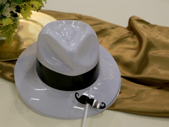 Plastic hats and mustache straws decorated the tables at a retirement celebration for R. Scott Phillips, former executive director of the Utah Shakespeare Festival on Feb. 27 in Cedar City.