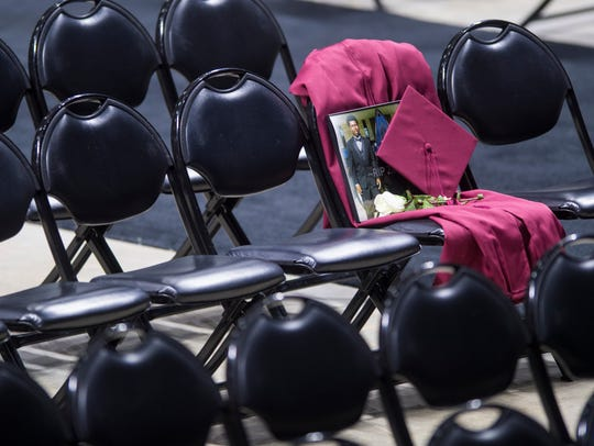 A seat is reserved for Zaevion Dobson's cap and gown