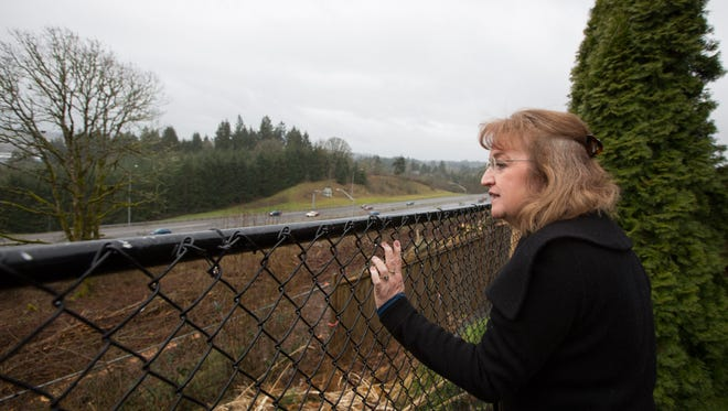 The view from Betty Buholts' backyard on Friday, March 3, 2017, in South Salem. Buholts' home is among four that were originally supposed to benefit from a sound wall that is nearing construction. However, a noise analysis has now excluded those homes from the project due to a retaining wall that officials say acts as a noise barrier. The trees were taken down in preparation for the sound wall and accompanying maintenance road.