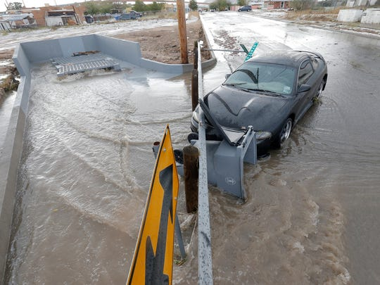 A car sits abandoned in Central El Paso after a heavy storm hit the area Wednesday afternoon. See more photos on 5B and at elpasotimes.com.