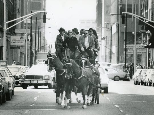 Dinwiddie Lampton Jr., in coachman's hat, drove his coach-and-four in 1979 on Fifth Street near Main Street in downtown Louisville. He was taking friends and city officials out to help attract interest in the Main Street Association's development and preservation projects.
