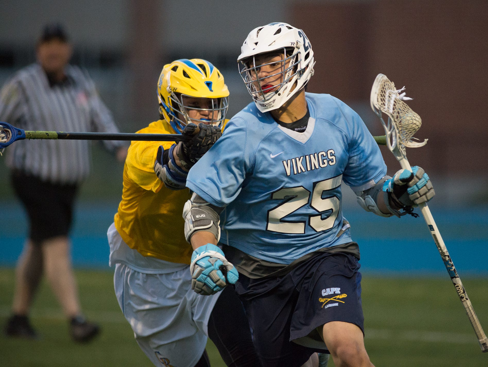Cape Henlopen's Erik-Stephane Stancofski (25) is hit from behind as he runs with the ball in their game against Caesar Rodney.