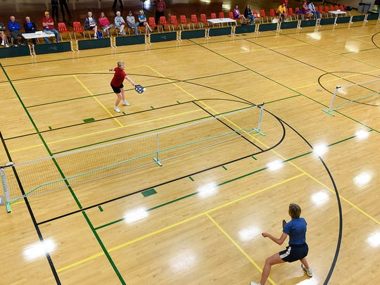 Kathy Waletzko, Holdingford, left, and Lisa Arndt, Golden Valley, in the first match of pickleball in the Minnesota Senior Games on Friday, May 20, at the Whitney Recreation Center.