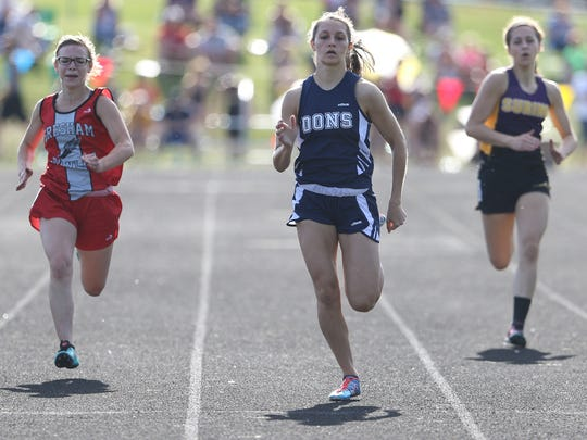 Columbus Catholic's Alexandra Hutchison, center, competes in the 200 meter preliminaries during the division 3 sectional track meet at Rosholt High School, Thursday, May 26, 2016.